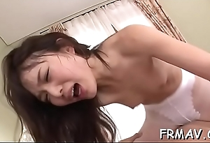 Pretty asian receives bawdy pussy toying while sucking schlong