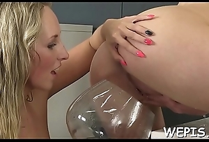 Bitchy beauties surrounding a foot job forth each other and make pissing