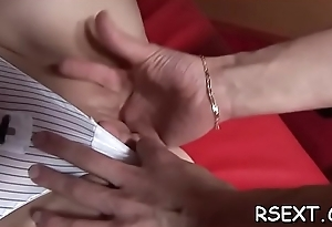 Erotic whore with large fake pair gives a steaming sexy blowjob